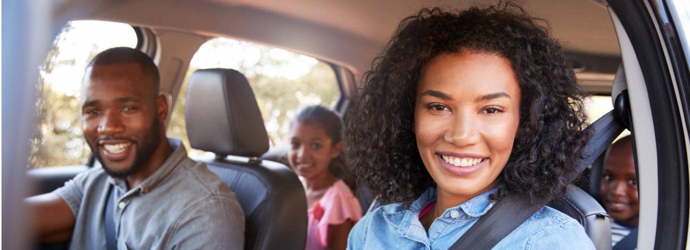 happy family on a car