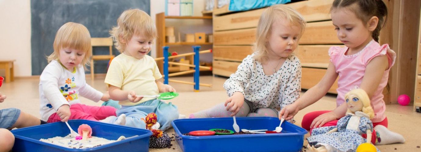 Group of children playing in kindergarten or daycare centre